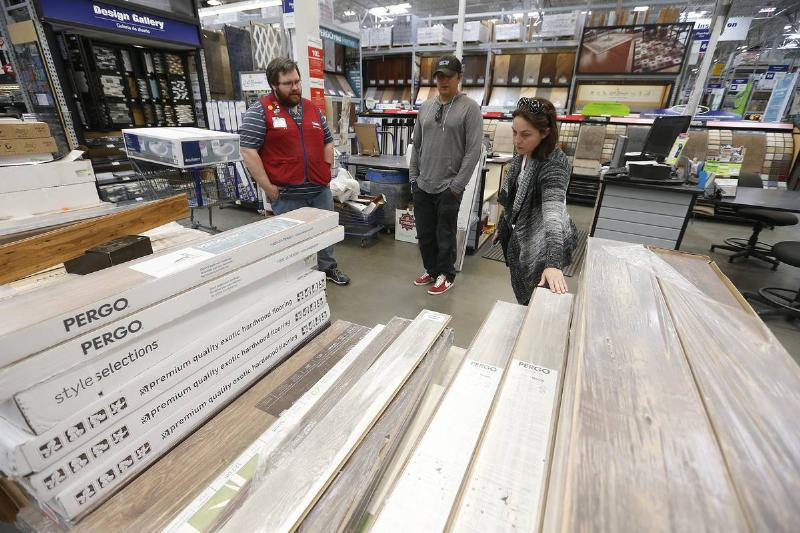 Lowe's Home Improvement employee Matt DeVore, left, helps customers Joe Carlo, center, and Saandra Bowlus, right, shop for flooring on Thursday, May 25, 2017, in Concord, Calif. (Aric Crabb/Bay Area News Group)
