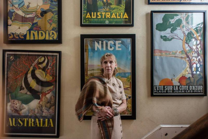 woman with vintage posters -657551218