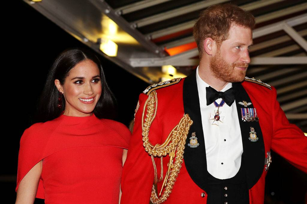 Britain's Prince Harry, Duke of Sussex and Meghan, Duchess of Sussex arrive to attend The Mountbatten Festival of Music