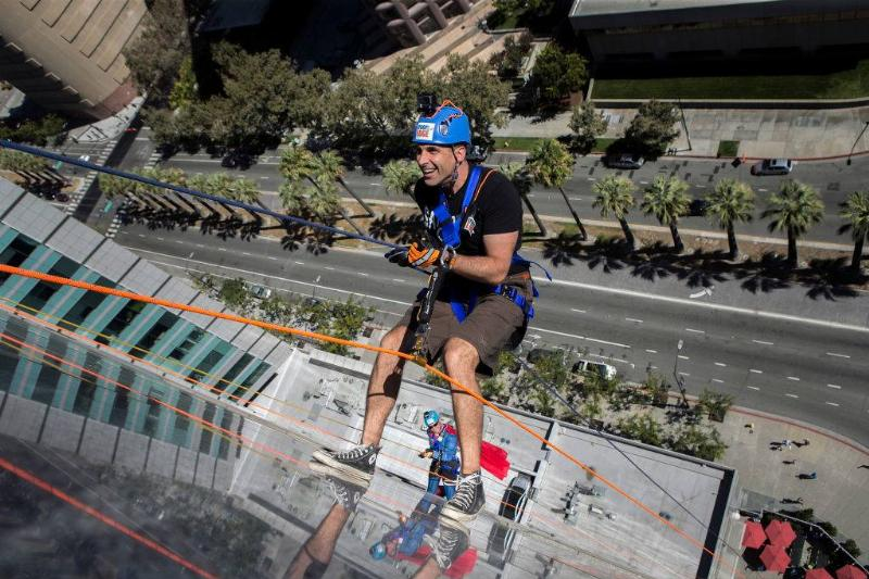 San Jose Mayor Sam Liccardo, foreground, and Sunnyvale Mayor Glenn Hendricks, background, rappel down the Adobe headquarters