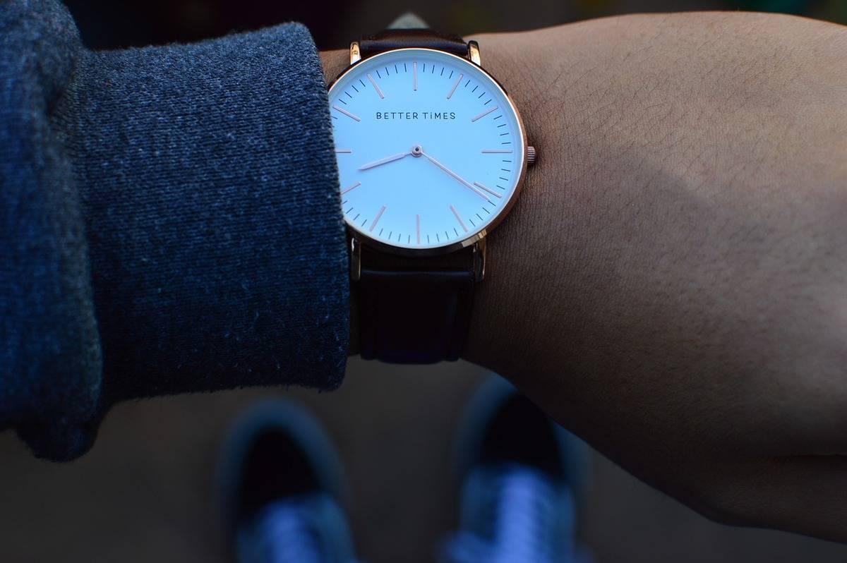 A person checks her wristwatch.