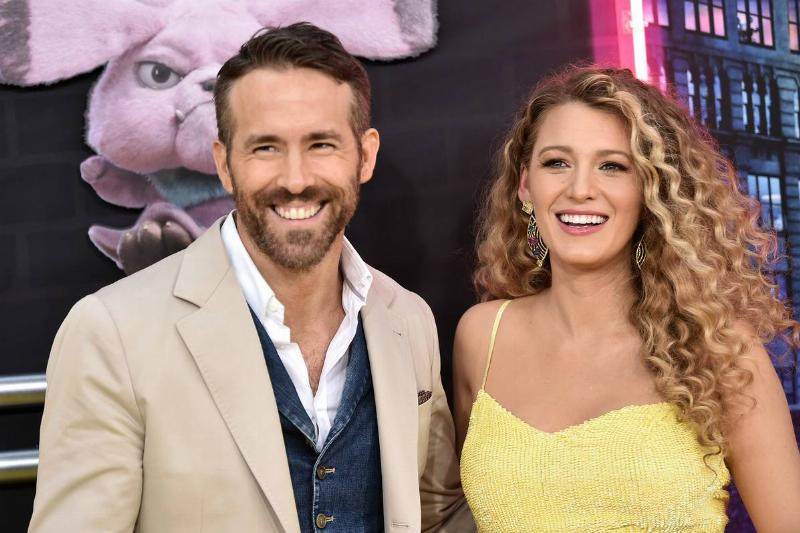 Ryan Reynolds and Blake Lively smile on the red carpet of the