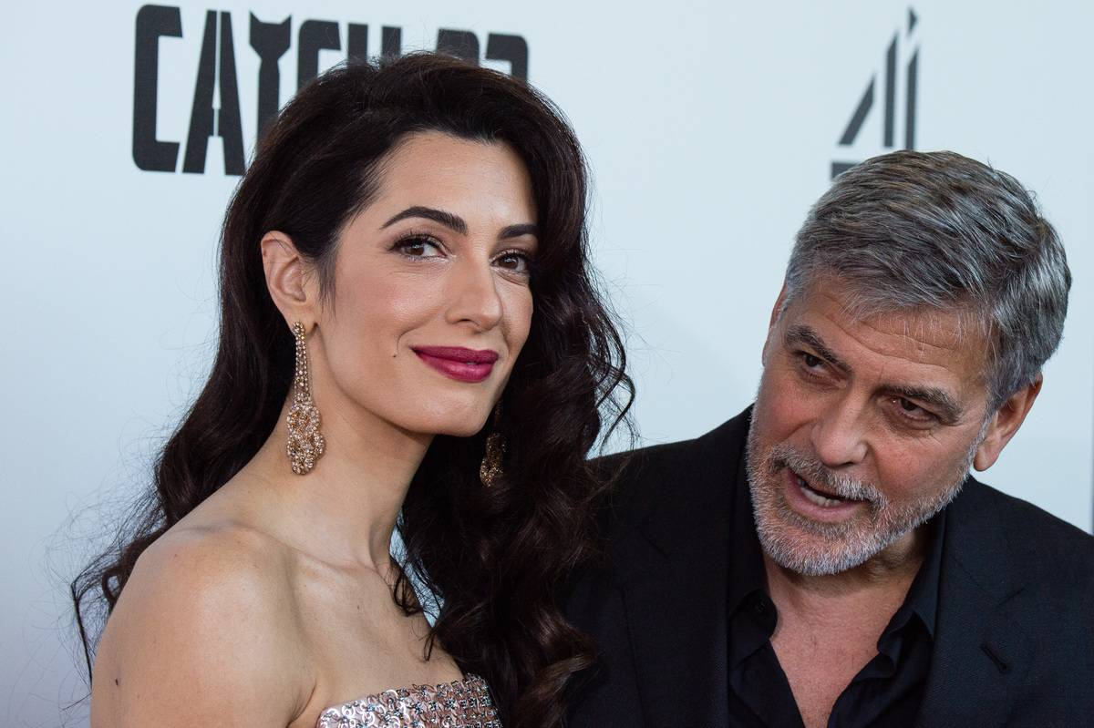 Amal Clooney and George Clooney attend the