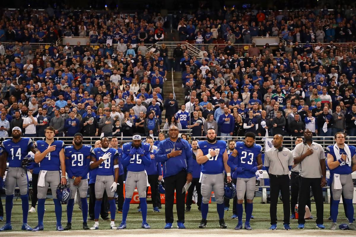 The St. Louis BattleHawks stand for the National Anthem before a game.