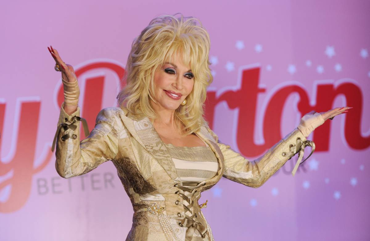 Dolly Parton faces media during a press conference in 2011.
