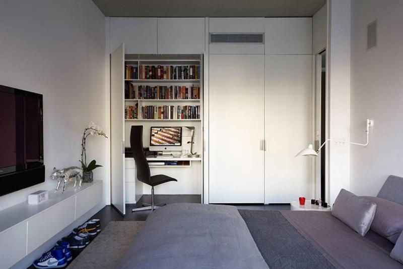A bedroom closet opens to reveal an office.
