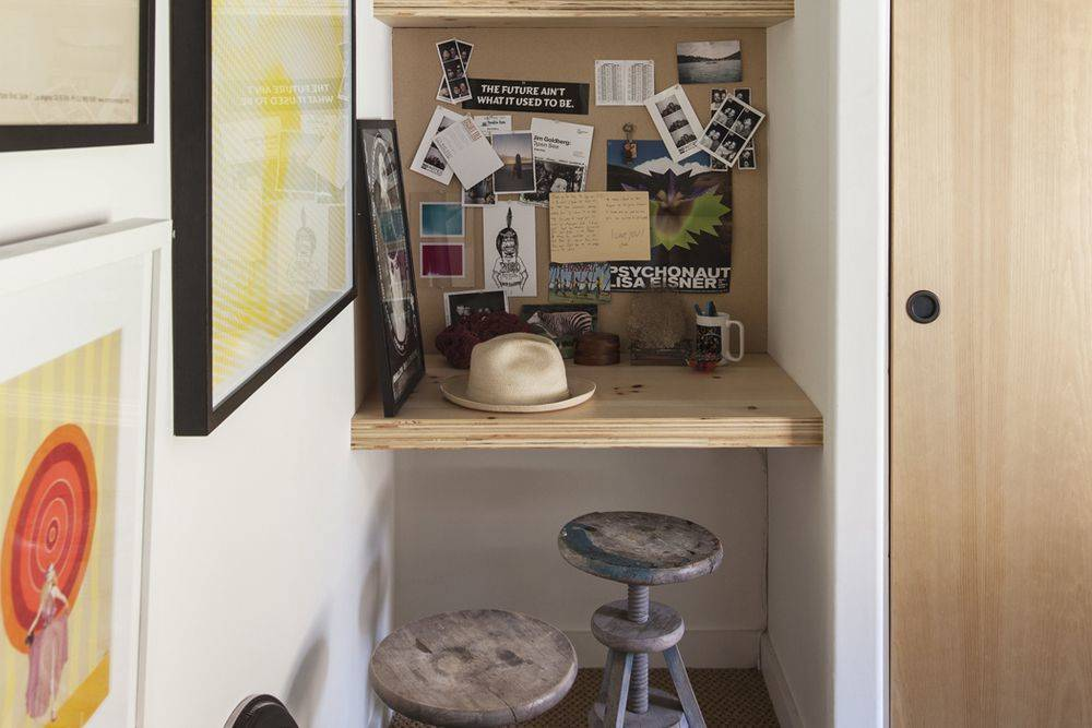 A small nook in a room is converted into an office space.