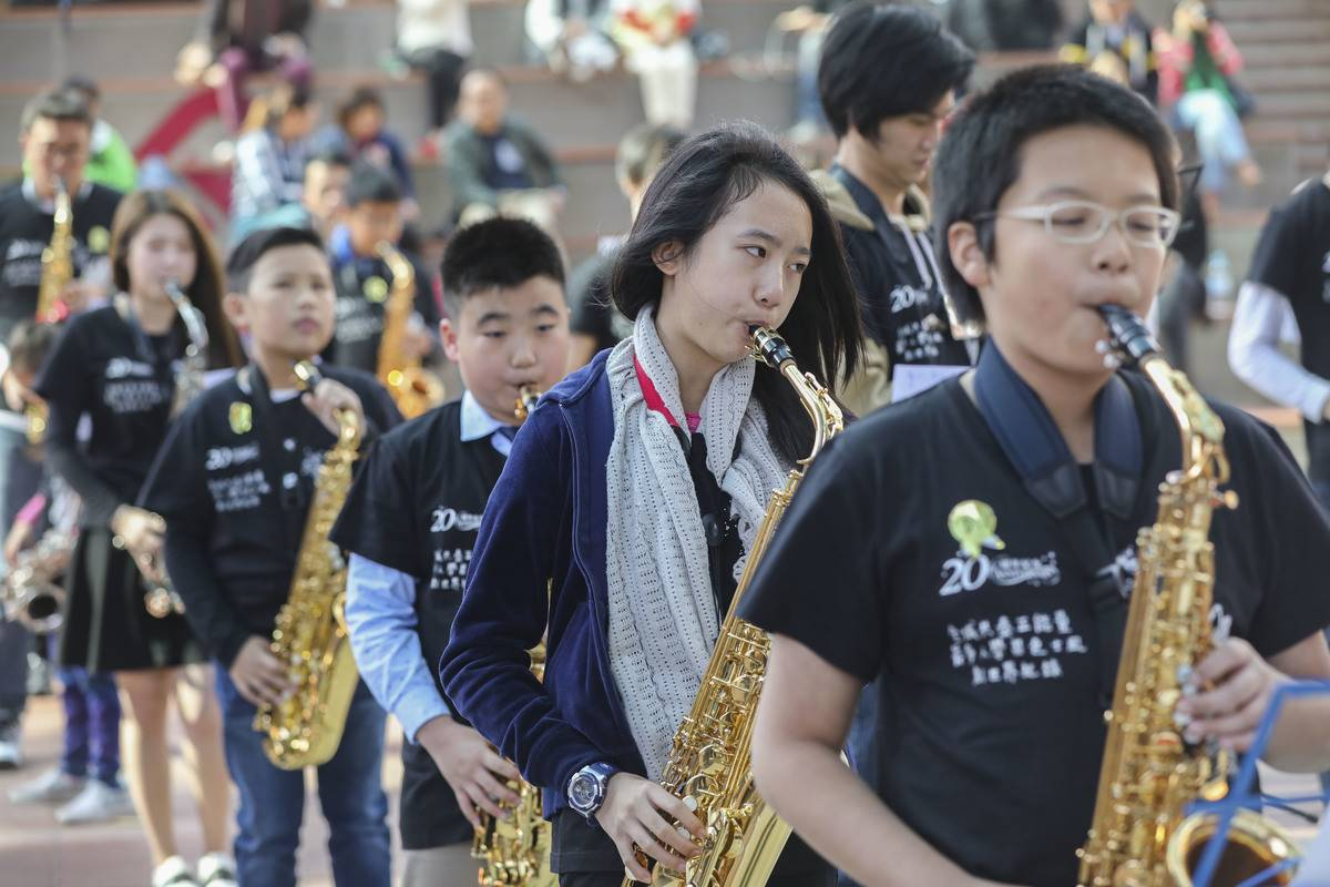 Students attend a saxophone lesson in Hong Kong.