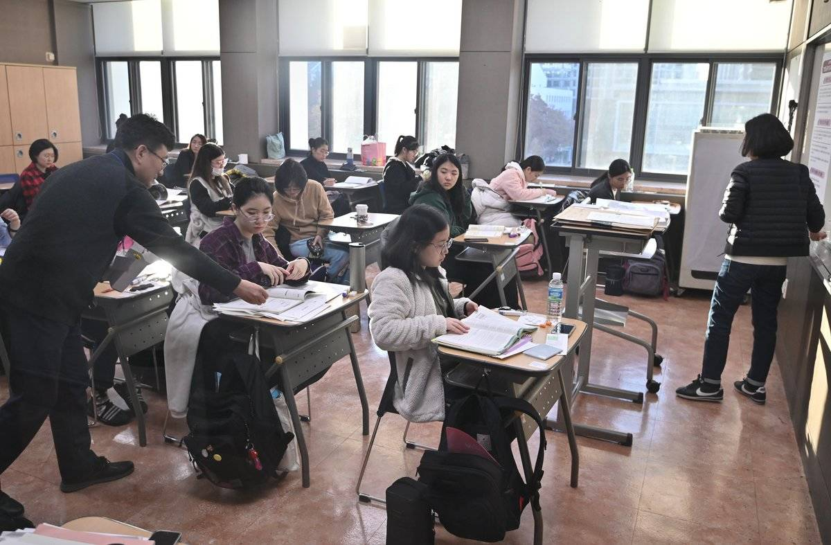 Students sit in a classroom in Seoul.