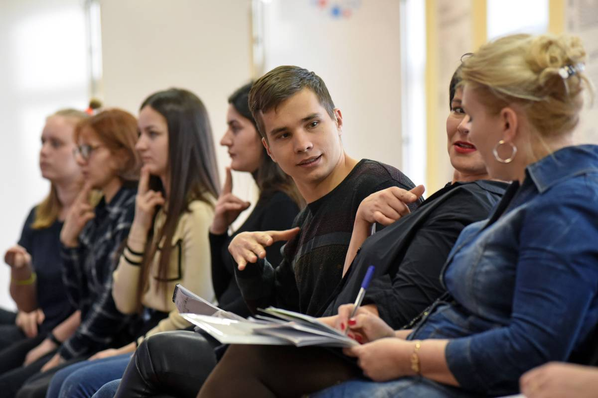 Russian students attend a sign language class.