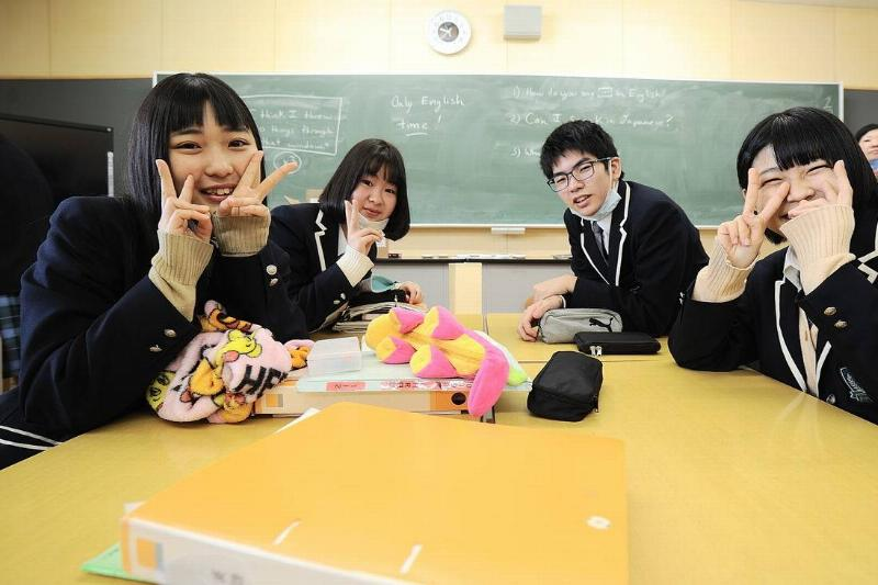 Students of the Futaba Mirai Gakuen Hight School pose for the photo in their classroom.