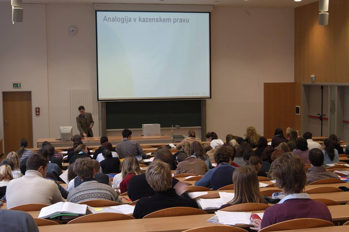 Students look at a presentation in a lecture hall in Slovenia.