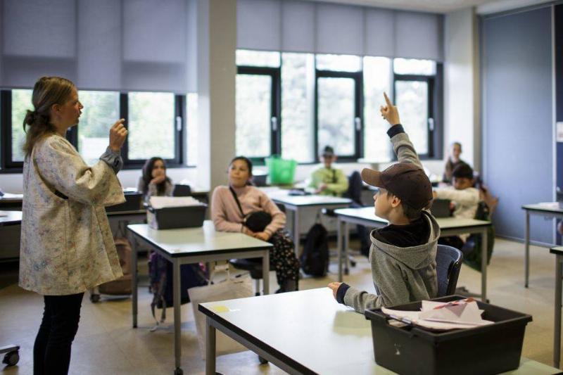 A Danish teacher speaks to her class.