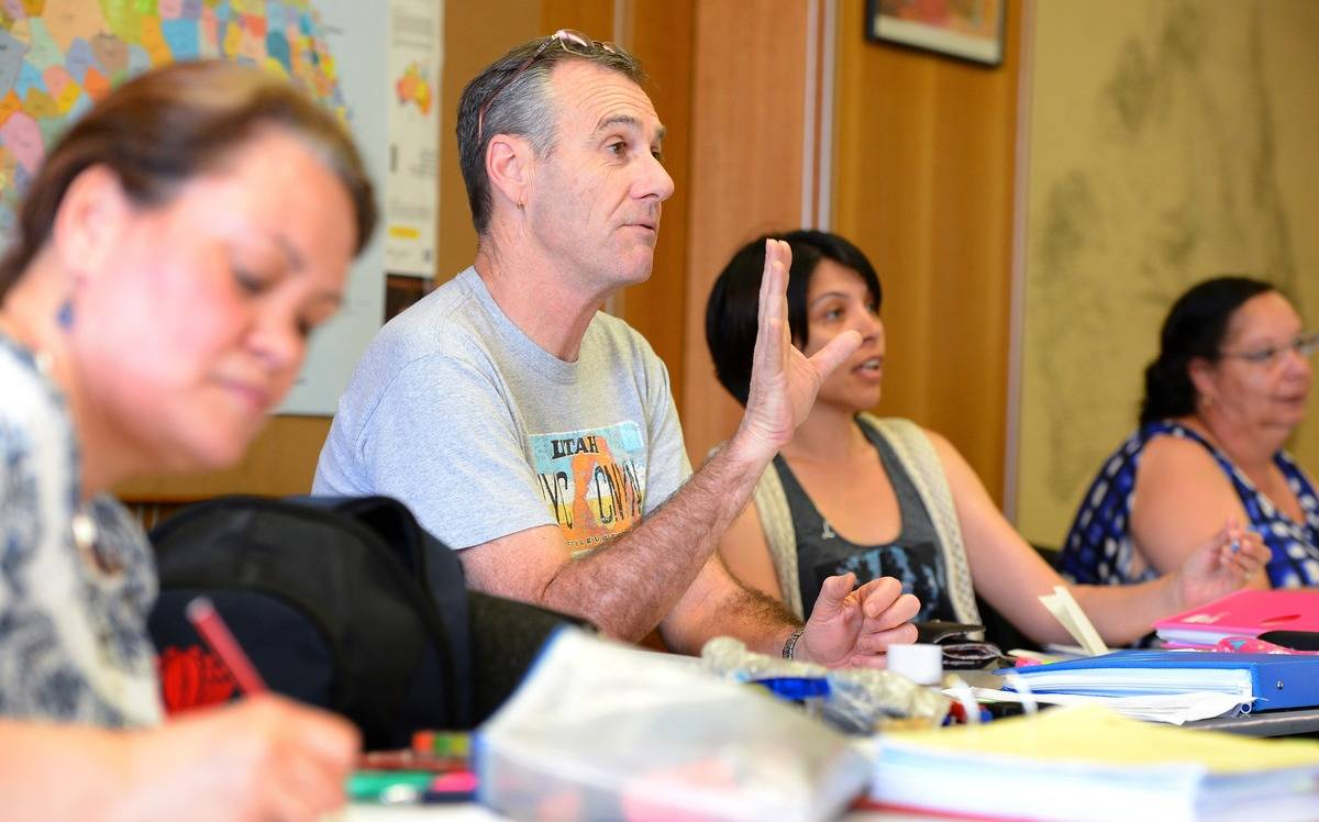 Adults attend a class to learn the Australian aboriginal language.