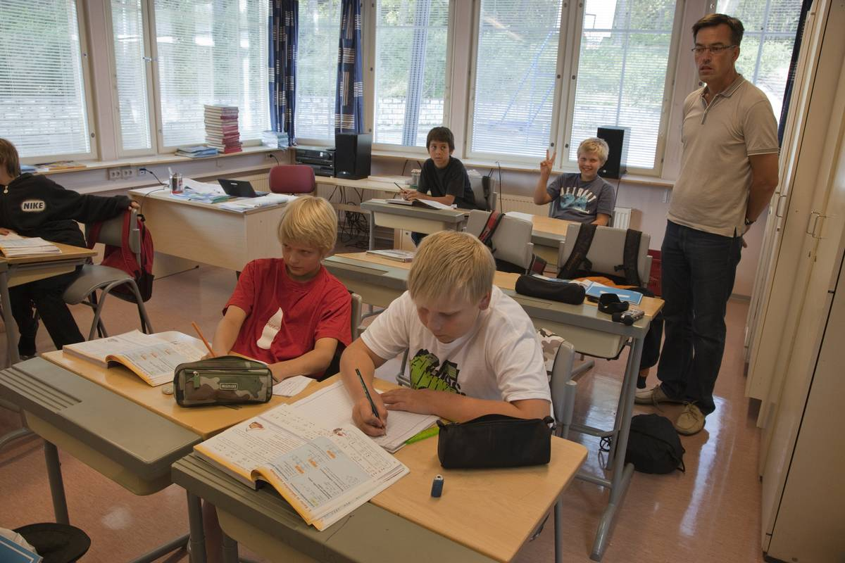 Students do work in a Finnish classroom.