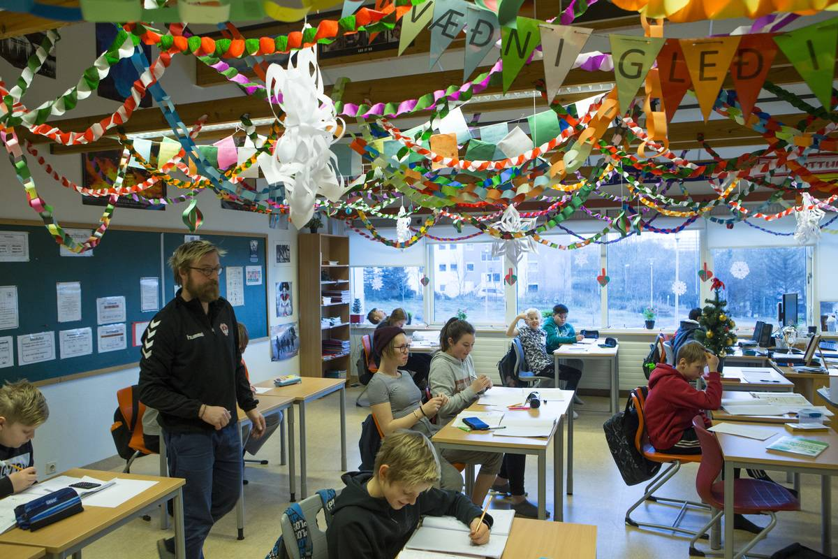 An Icelandic classroom has Christmas decorations hanging from the ceiling.