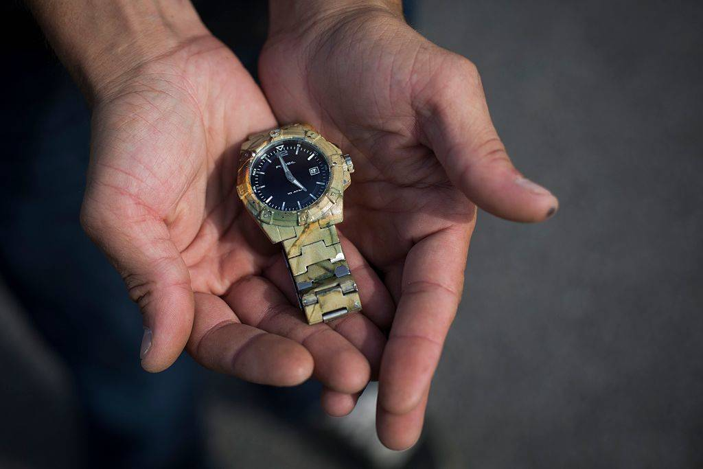 Jeremy Revoy, 34, holds a Fossil watch that he found with his metal detector