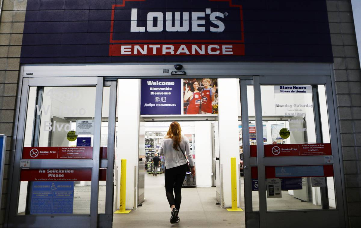 A woman walks into a Lowe's store.
