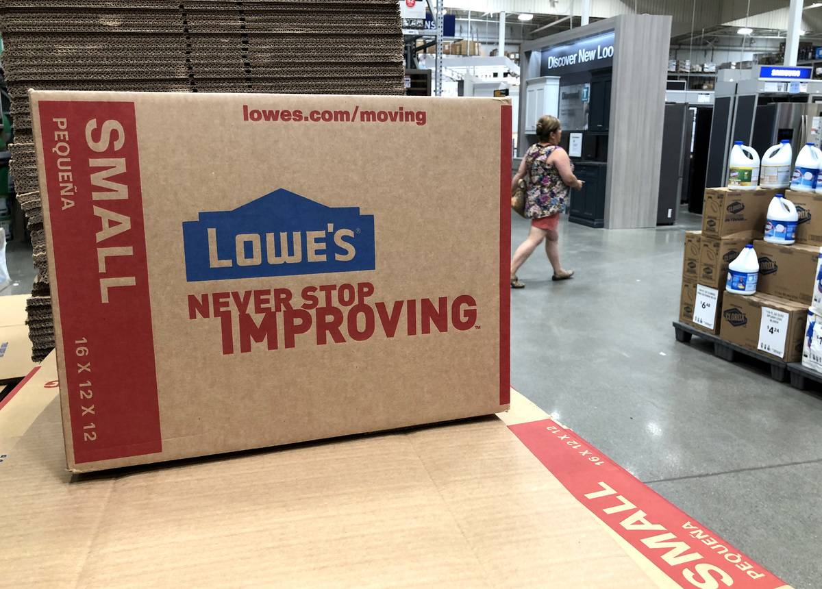 A Lowe's shipping box is displayed in a distribution center.