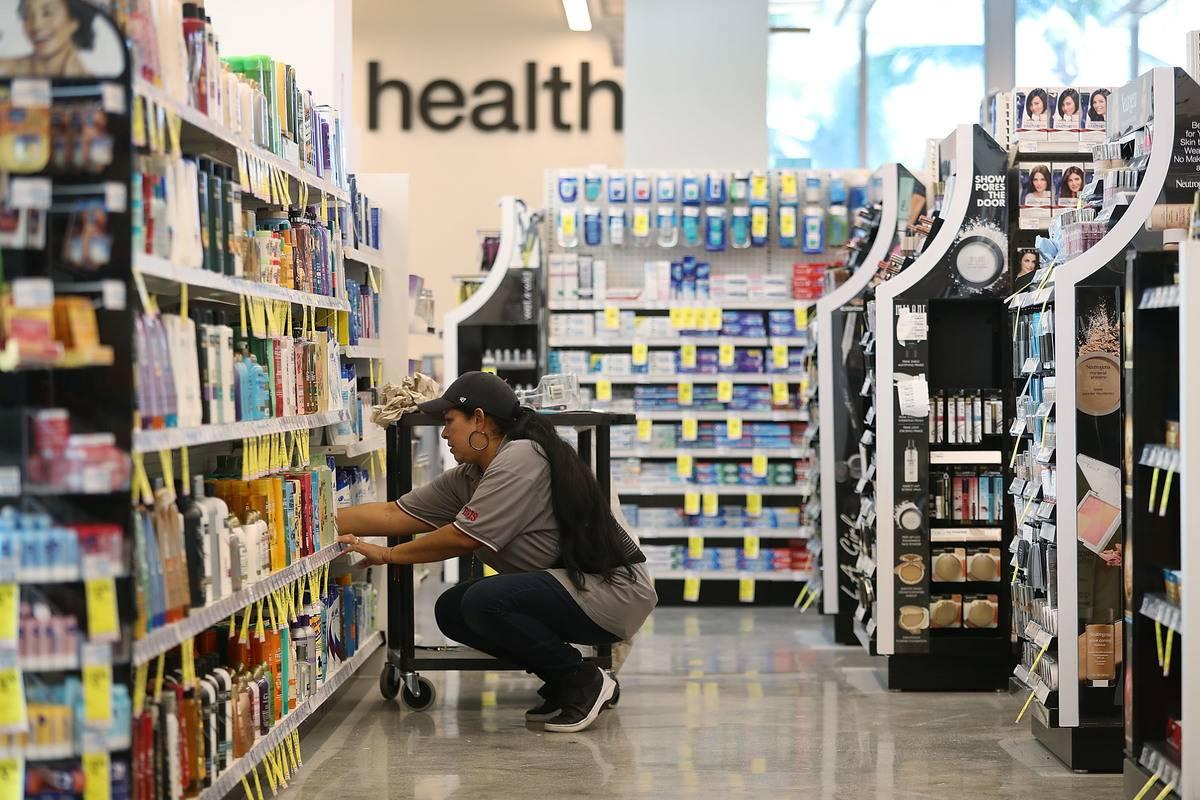 An employee stocks shelves at CVS.