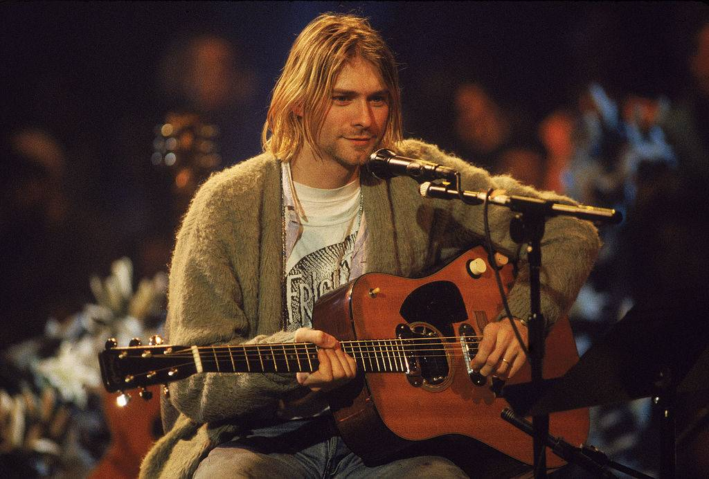 American singer and guitarist Kurt Cobain (1967 - 1994), performs with his group Nirvana at a taping of the television program 'MTV Unplugged,'