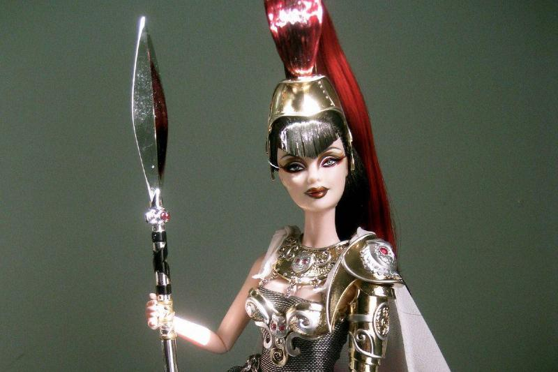 Athena Barbie wears black and gold Greek armor.