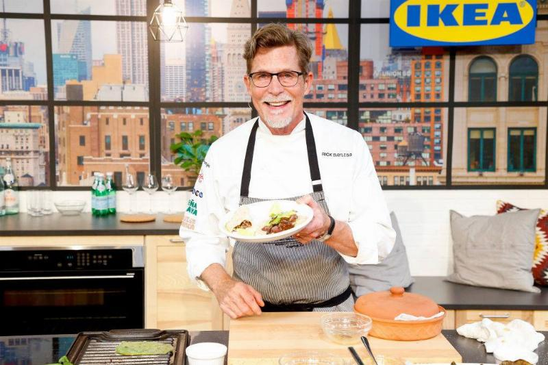 Rick Bayless with a plate