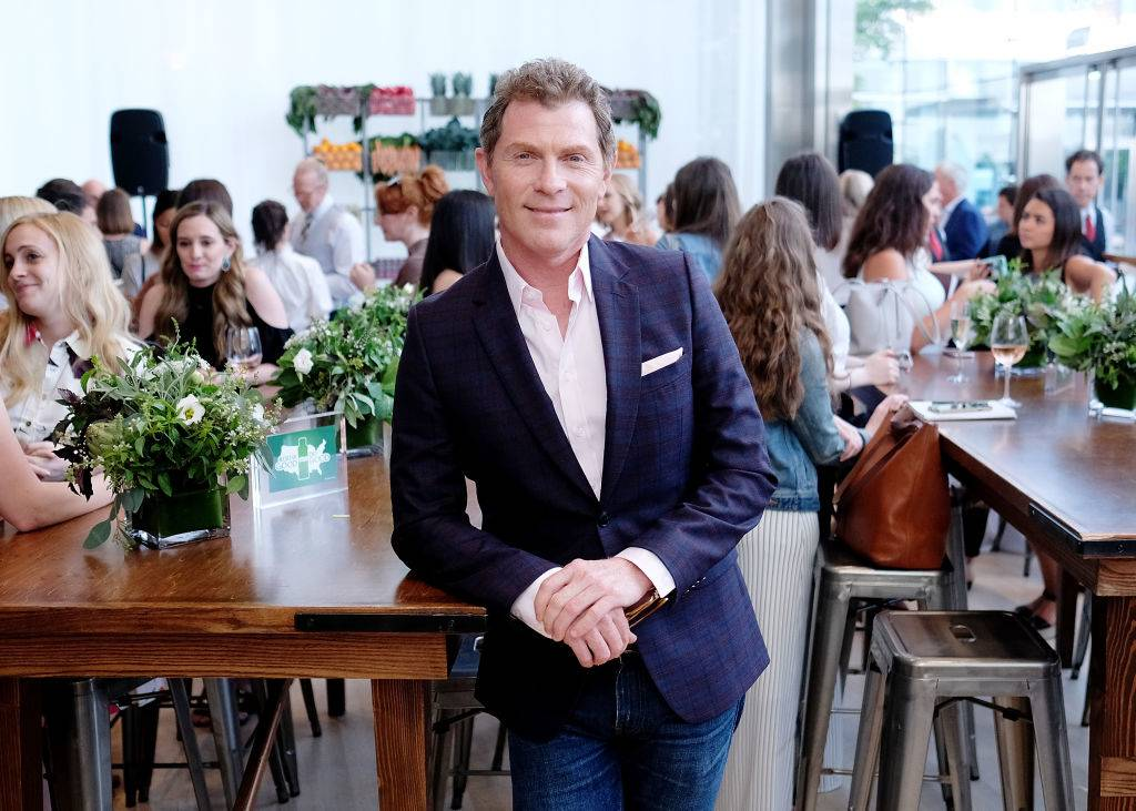 Bobby Flay leaning on table