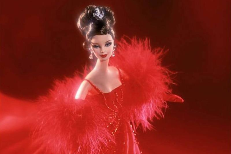 The 2001 original Ferrari Barbie is seen in a red evening gown.