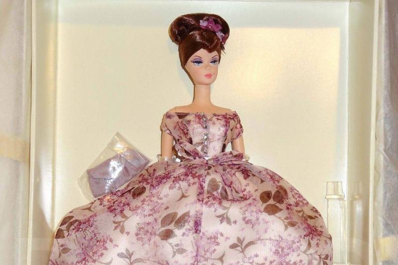 Violette Barbie is seen in a box.