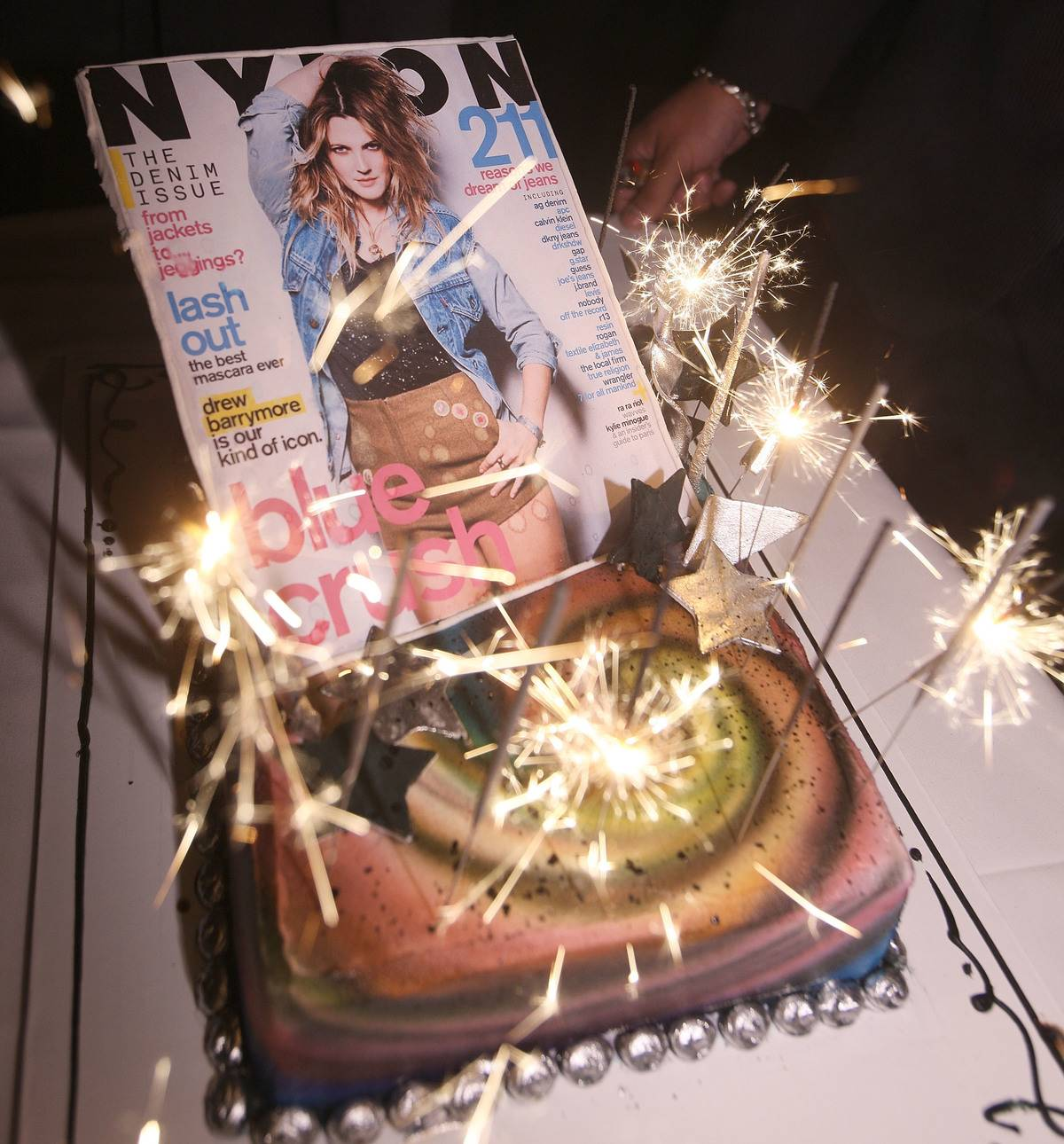 Nylon celebrates its birthday by placing the magazine on top of a cake with sparklers.
