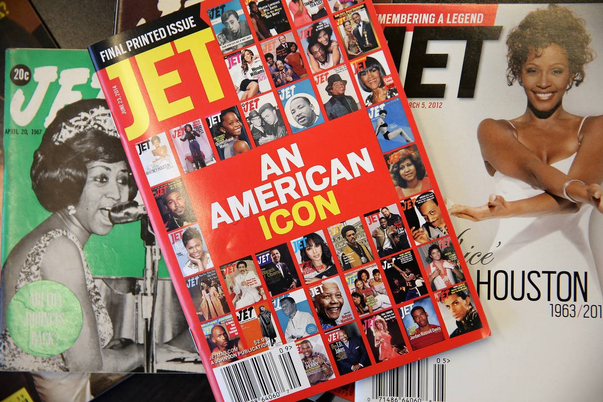 Copies of Jet magazine are piled on top of each other.