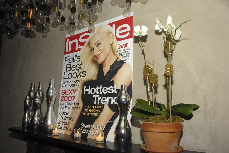 A copy of InStyle magazine stands on a display shelf.