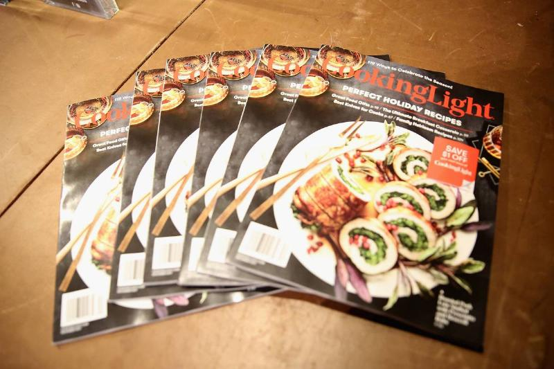 Copies of Cooking Light magazine lay on a table.