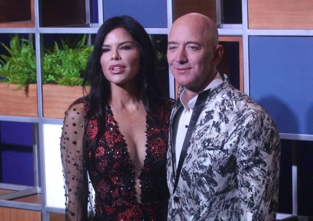 Amazon CEO Jeff Bezos, right along with American news anchor Lauren Sanchez po