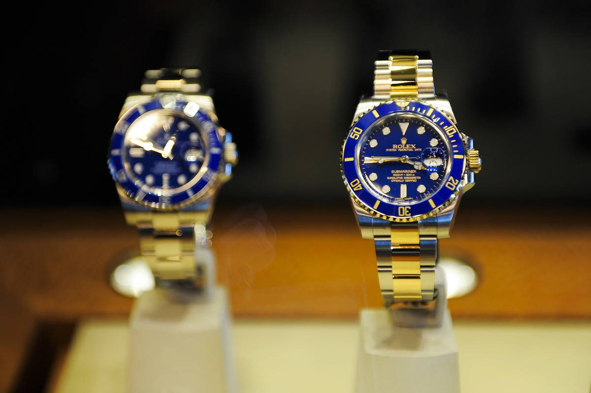 New Rolex watches are on display.