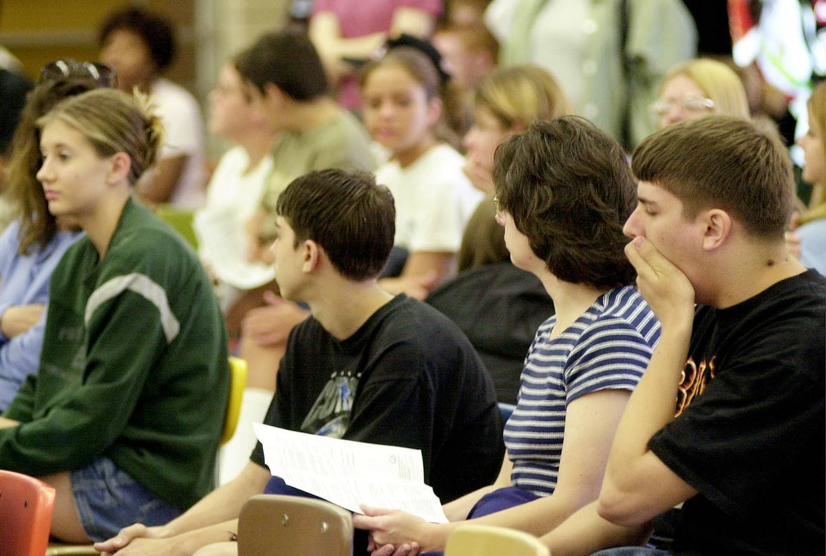 High school students sit in a crowded classroom.