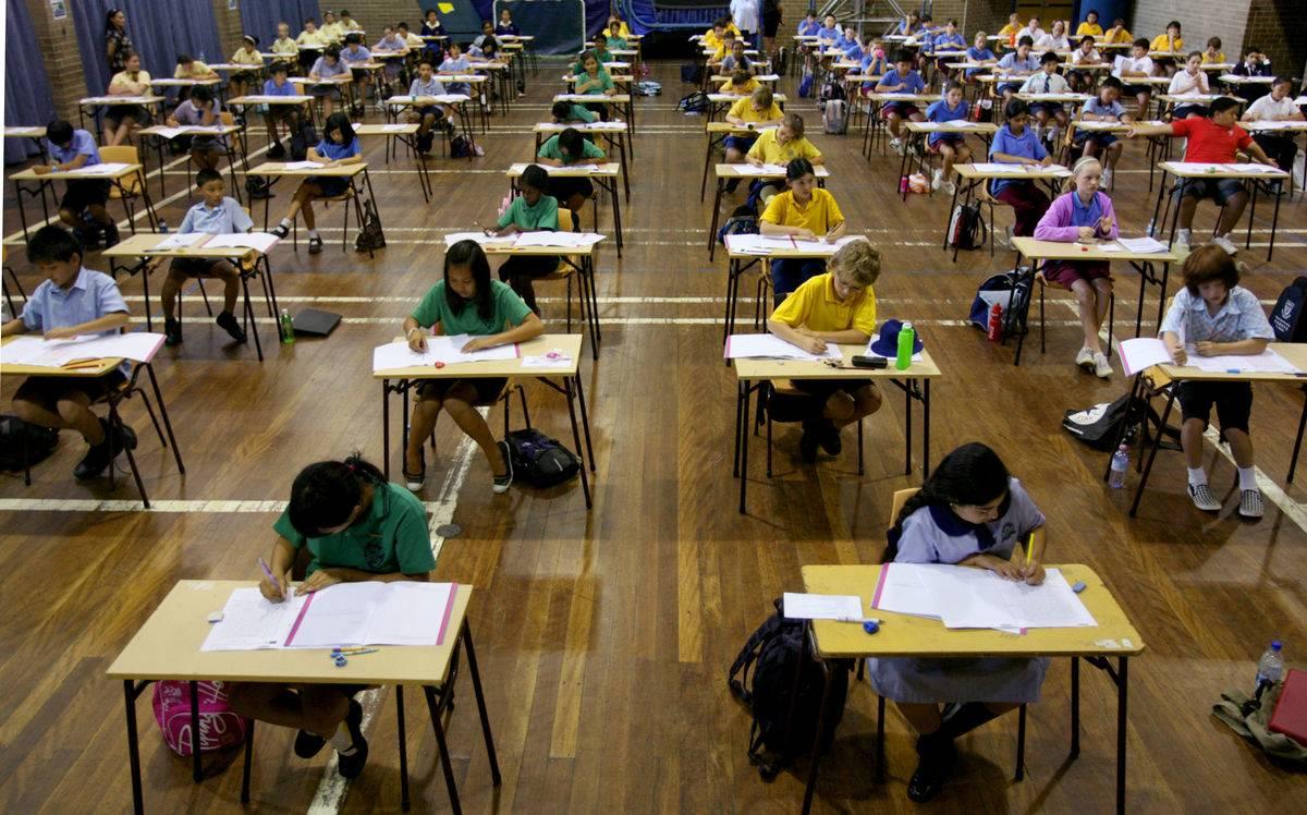 Students from six Arizona schools take high school exams.