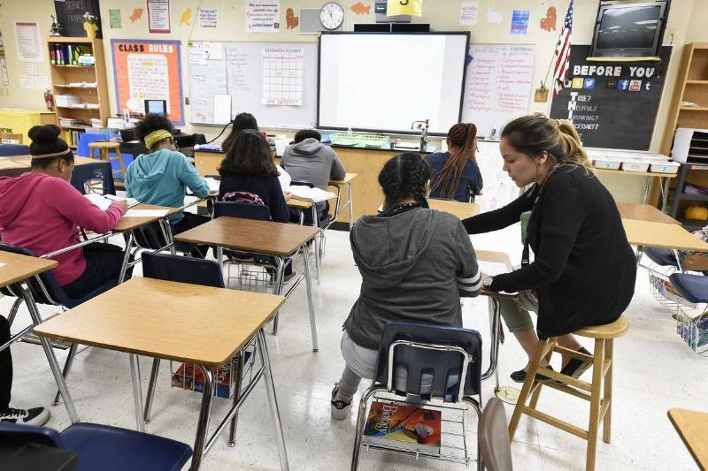 A science teacher helps students in a South Dakota high school.