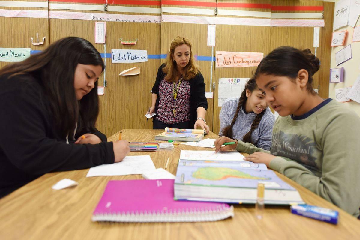 A Spanish teacher instructs students in California.