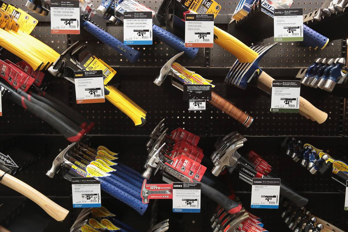 Tools hang in a Home Depot.