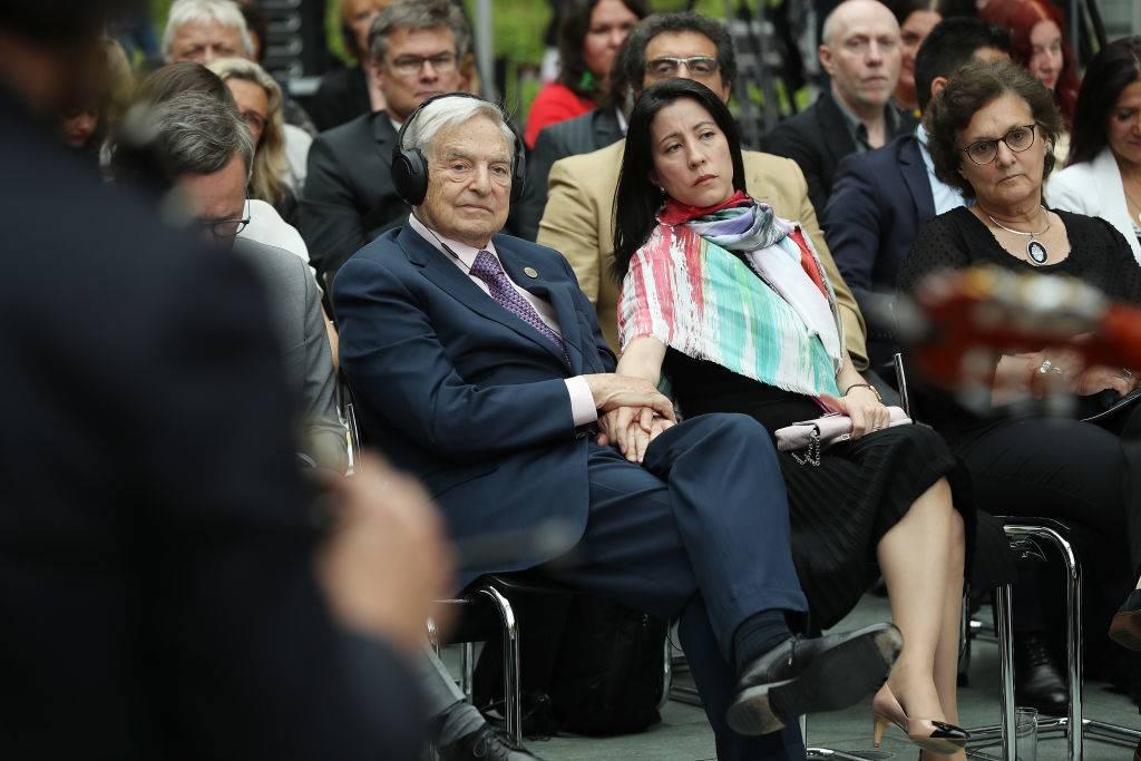 Soros seated