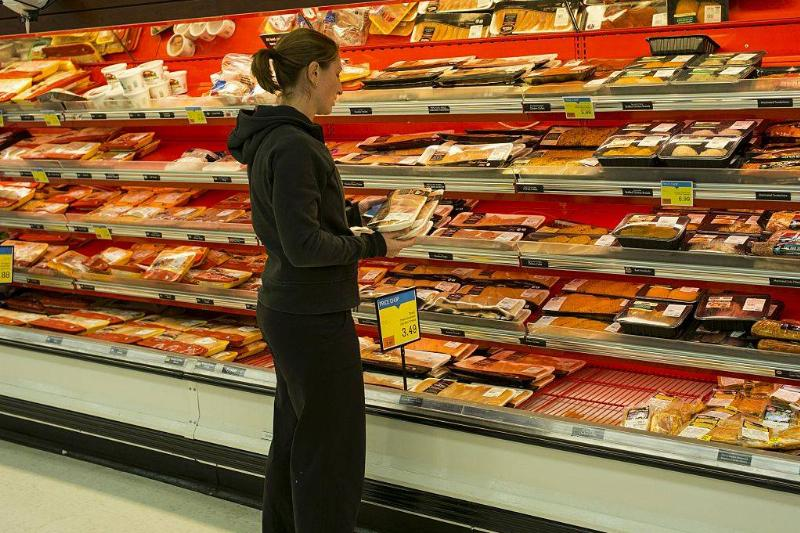 Woman looking at meat