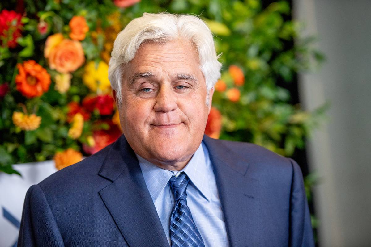 jay leno posiong for a picture