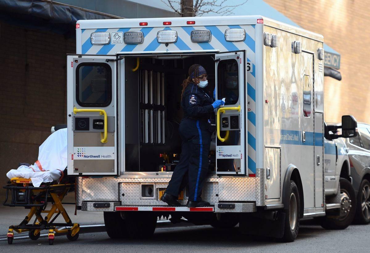 A paramedic sanitizes an ambulance.