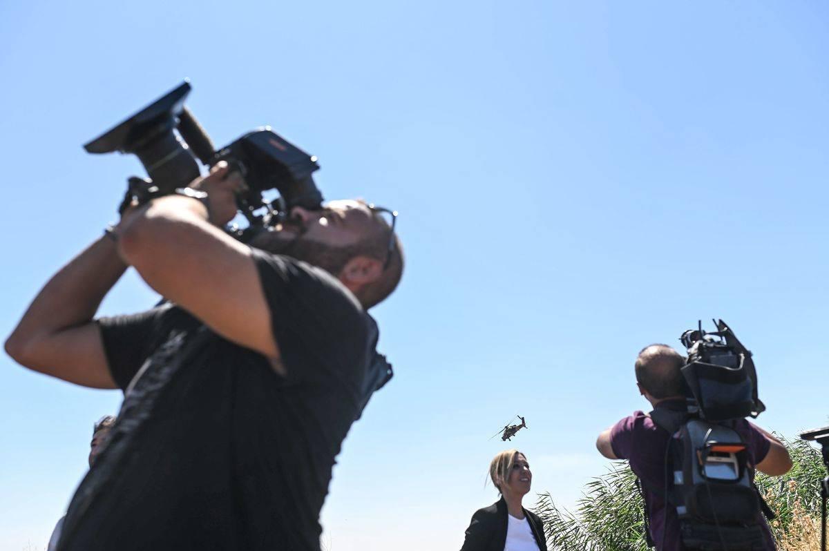 Reporters film their surroundings in Turkey.