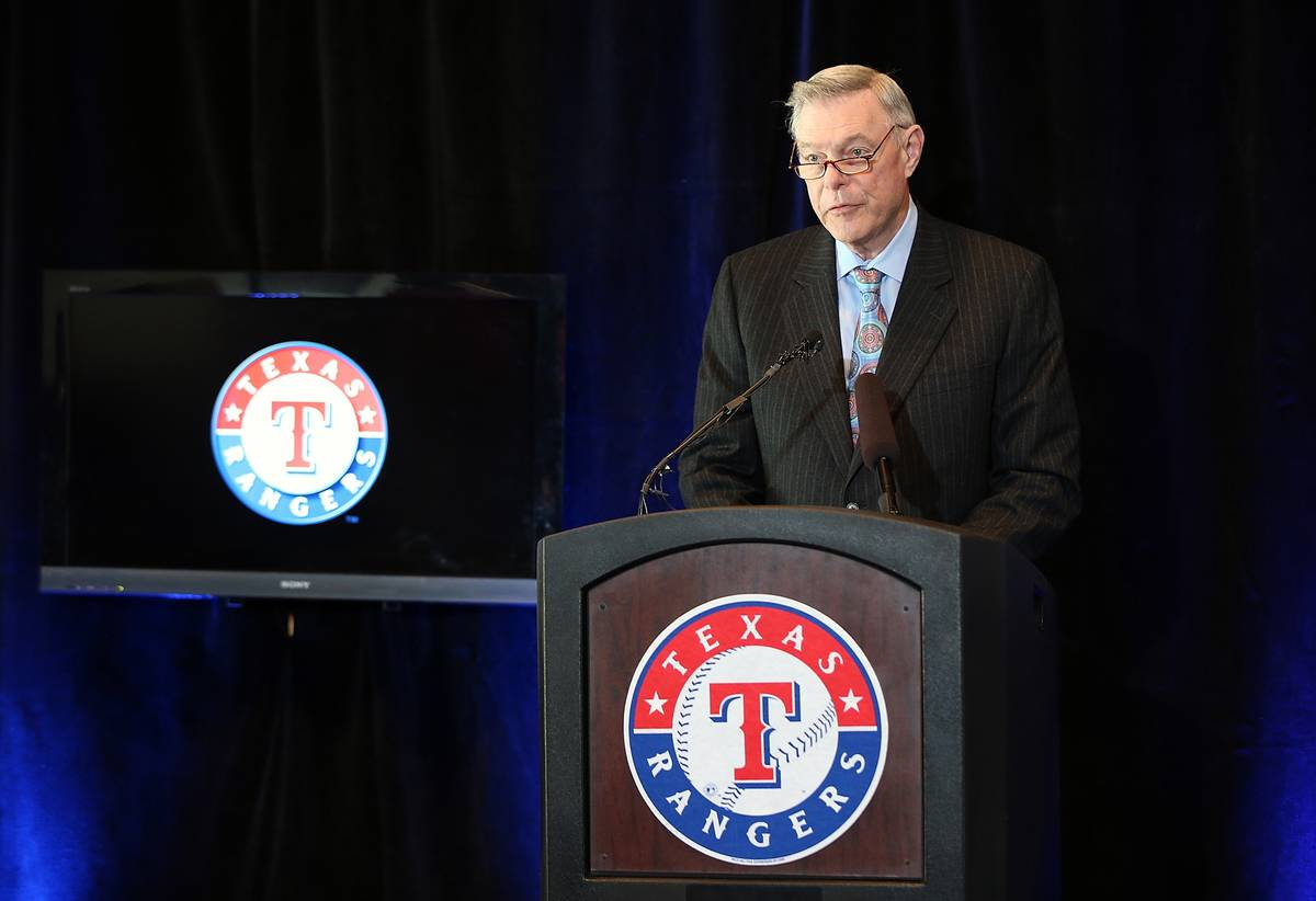 Ray Davis, co-owner of the Texas Rangers, stands at a podium and gives a speech.