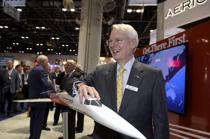 Robert Bass playfully flies a small model of a jet from Aero Supersonice.