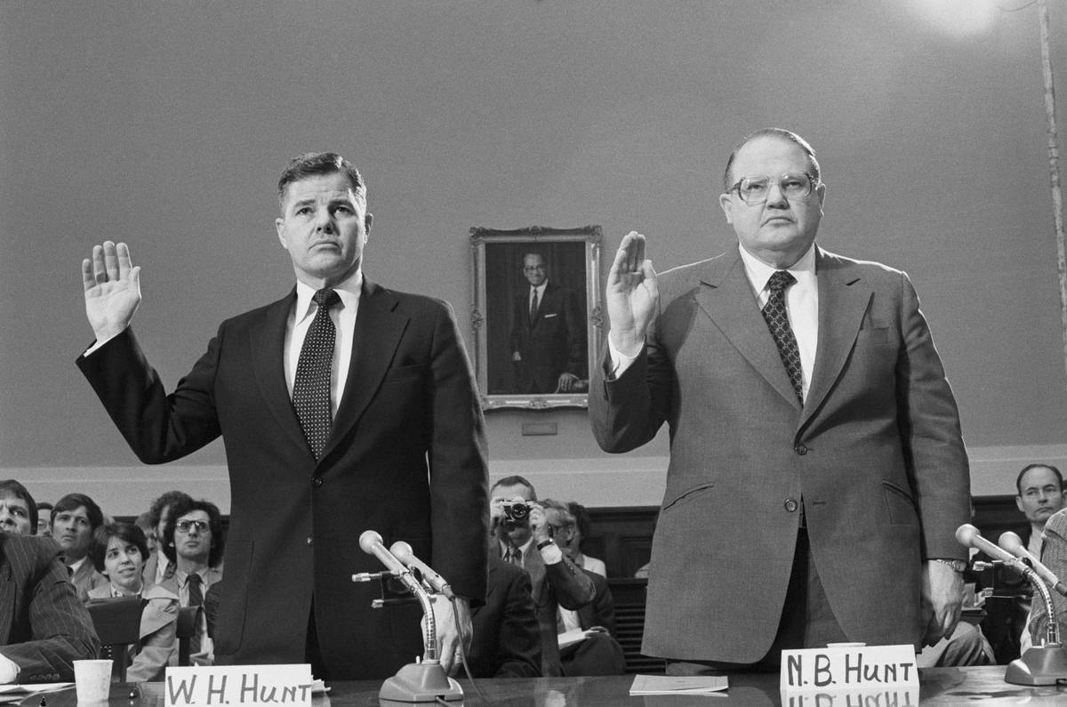 William Hunt (left) and his brother stand before a committee during the collapse of the silver market.