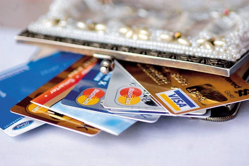 Credit cards spill out of a woman's purse.